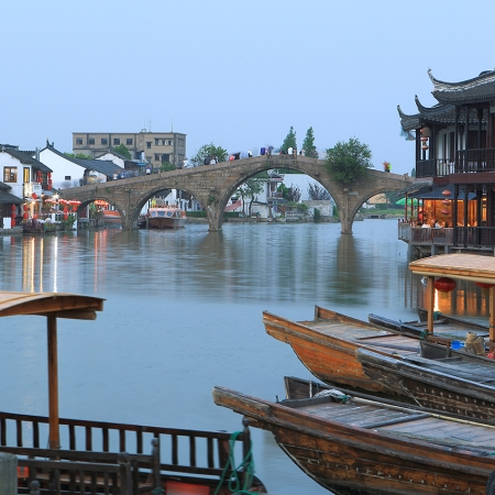 Tour Zhujiajia Water Village to see live in harmony with water and the land.