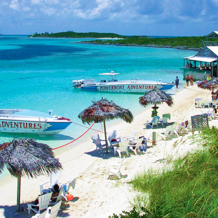 High-speed boat ride to snorkel coral reefs, feed stingrays, sharks, and iguanas.