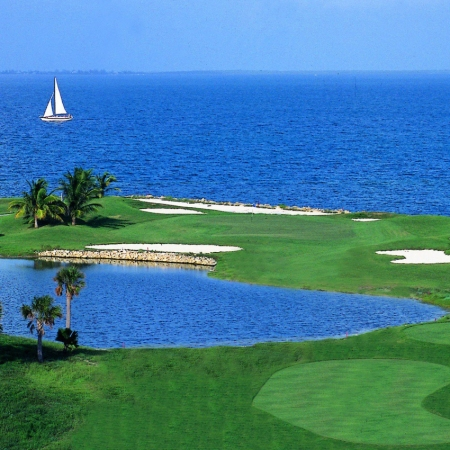 North Sound Club offers an 18-hole championship course & stunning ocean views.