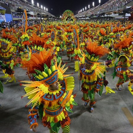 Take part in the real Samba Schools Parade during the legendary Rio de Janeiro Carnival.
