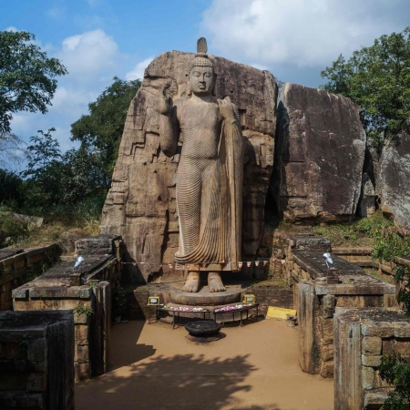 Aukana - This Buddha statue was carved during the reign of king Datusena in the 5th century. Height of this Buddha statue is more than 40 feet (12 m) and resting on beautiful lotus stone pedestal.   This amazing Buddha statue carved according to the asisa mudra and this statue has built in a mathematical way. That is, when rainy days you can see drops of water that falling from the point of nose straightly down to the center of between lord Buddha's feet.
