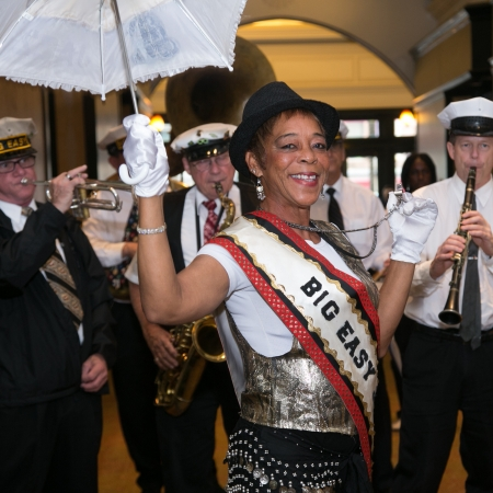 Dance in the streets and parade through the French Quarter with your own private second line band.