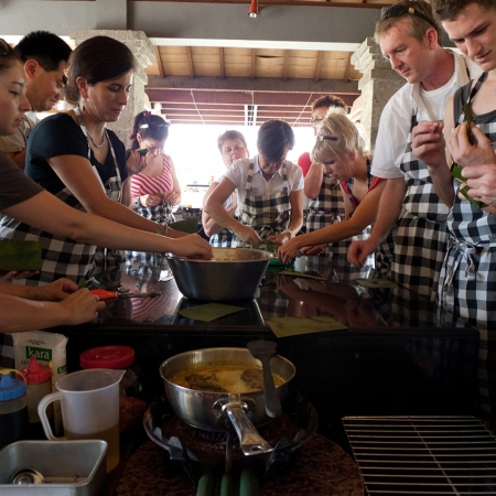 Visit a traditional Balinese family compound to learn how to prepare and cook the revered food.