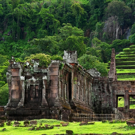 Visit the UNESCO site of Wat Phou, then cruise along the Mekong River to Don Daeng Island.