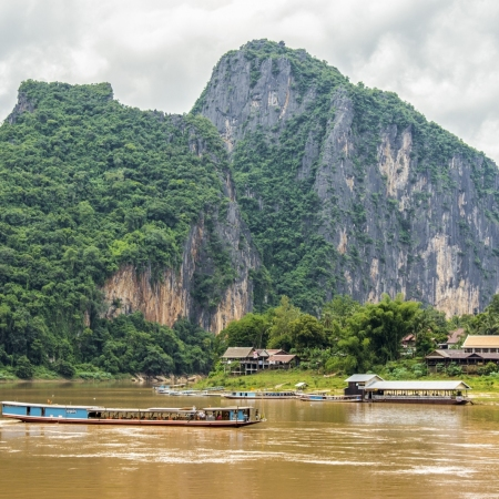 Embark on a memorable Mekong River experience heading down steam to the spectacular Kuang Si Waterfall.