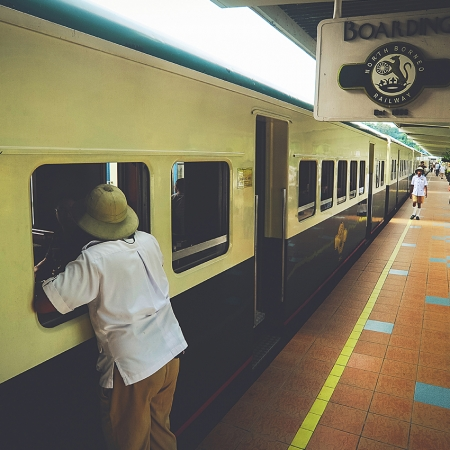 Ride from Tanjung Aru Railway Station, passing through developing towns into the scenic countryside with village houses dotting this picturesque view.