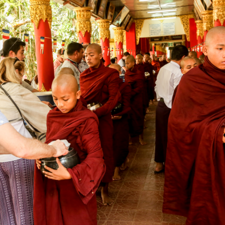 Participate in an auspicious donation ceremony at the Kalaywa Monastery, offering food items to over 1,000 monks and novices.
