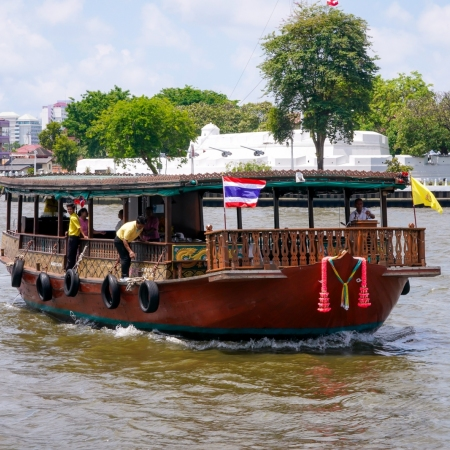 Enjoy the wonders of Bangkok from the relaxing deck of a converted rice barge as it leisurely winds its way down the majestic Chao Phraya River.