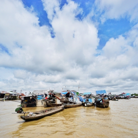 Journey from Ho Chi Minh City to a landscape of lush green rice paddies and sleepy villages on the mighty Mekong Delta.
