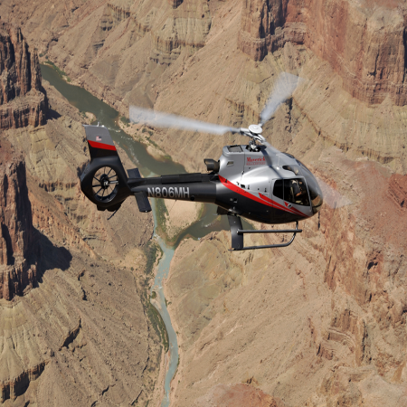 Helicopter ride over key landmarks like the Grand Canyon, Hoover Dam, Las Vegas Strip and more.