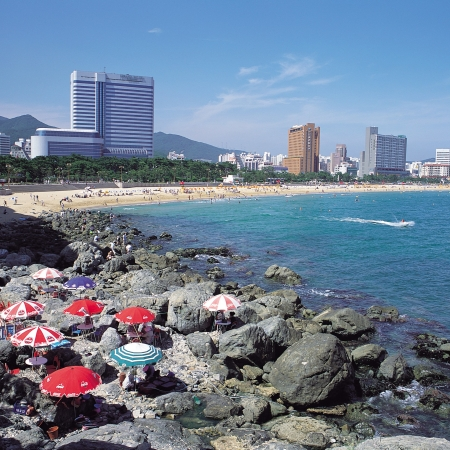 Relax on the beautiful sands at Haeundae Beach in Busan.