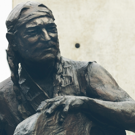 Willie Nelson bronze sculpture rests outside of the brand new studios of Austin City Limits.