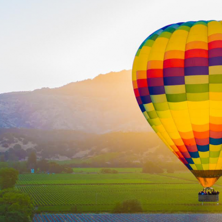 Experience a hot-air balloon ride over the valley
