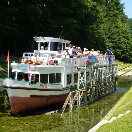 """Sail on grass"" through Ostróda Canal, using remarkable system of tracks between picturesque lakes – the only existing in the world."