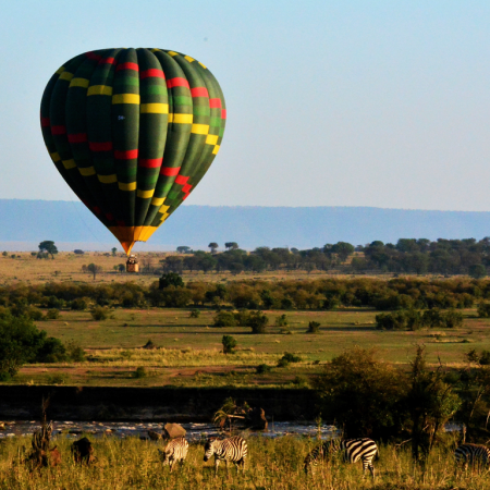 Game viewing over African savannahs as you float in a hot-air balloon