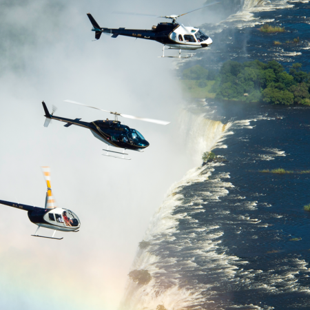 Take helicopter flips in unison over the Victoria Falls